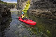 senior traveler enjoying a kayaking tour on a multiday tour from Dublin