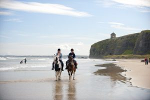 horse riding on a beach in Ireland