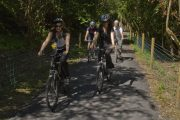 Two females and two males cycling on a sunny day on the great western greenway Westport , Mayo