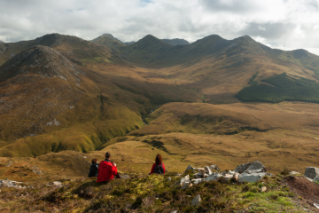 small group of hikers enjoying the views overlooking Connemara
