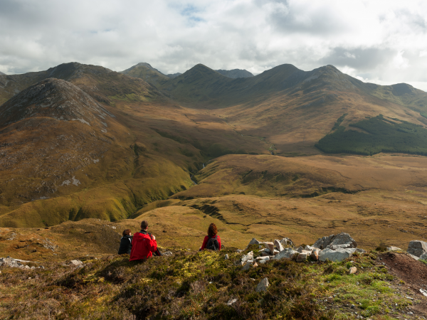 small group of hikers enjoying the views overlooking Connemara