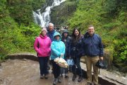 small group tour enjoying exploring Torc Waterfall and Killarney National Park , Kerry, Ireland