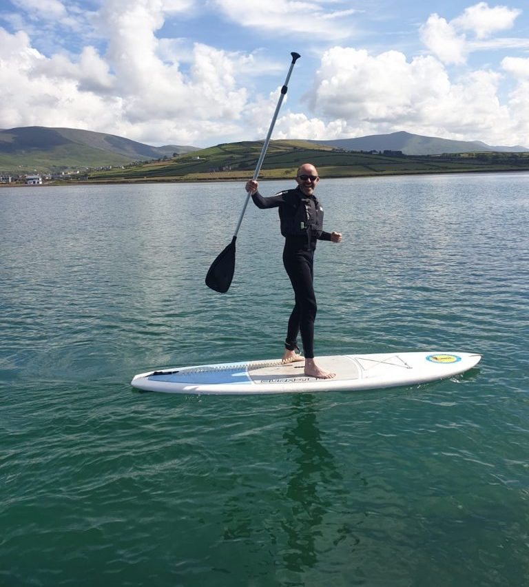 Local guide on a SUP outdoor adventure in Dingle Ireland