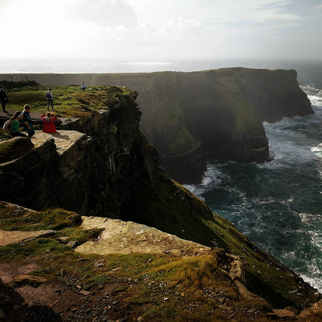 Enjoying the views at the Cliffs of Moher Ireland, small group tours