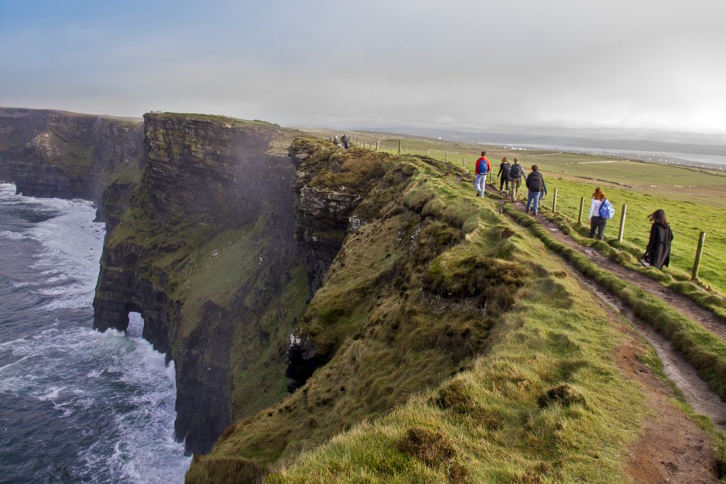 An Irish Experience small group tour hiking along the mighty Cliffs of Moher Ireland