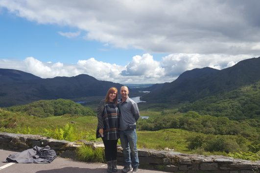 couple smiling for a photo at Ladies View , Killarney National Park