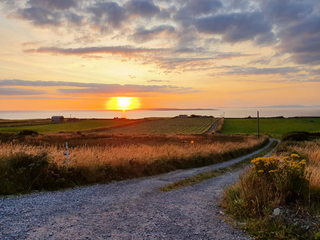 sunset view and small country road on self drive tour of Ireland