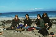 a group of girls having a picnic on the beach on the Aran islands