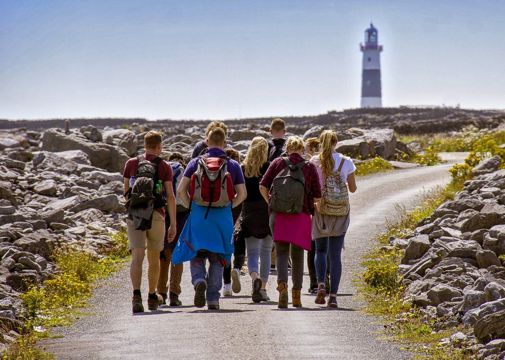 a small group hiking the roads of Aran islands