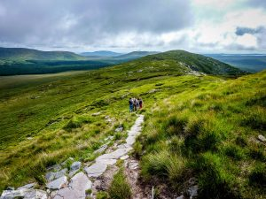 A family hiking on private tour at Diamond Hill, Connemara National Park