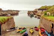 preparing for a kayaking adventure tour at Ballintoy harbour , Northern ireland