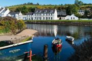 colourful harbour view of Cushden hotel with small blue and red boats