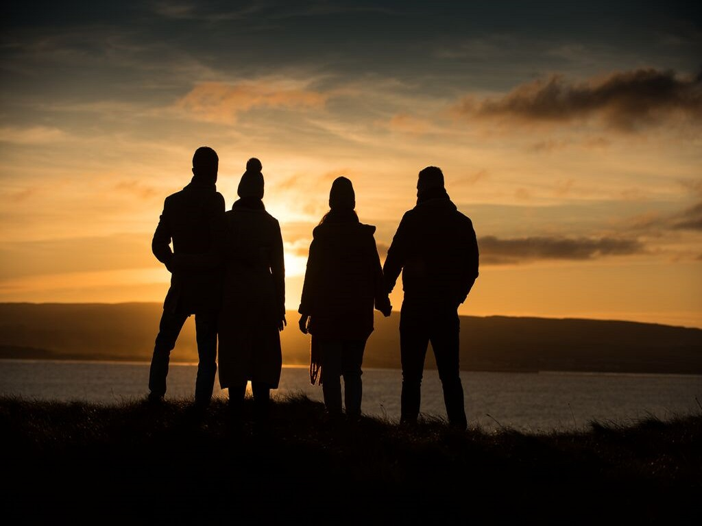 A small group tour enjoying the sunset at Portstewart