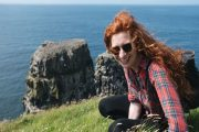A girl enjoying the views from Ratlhlin Island , Northern Ireland small group tours