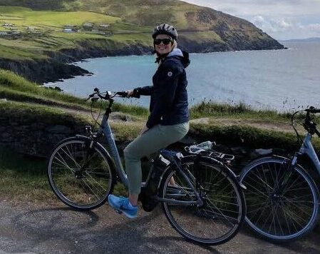 woman e biking along slea head in Dingle