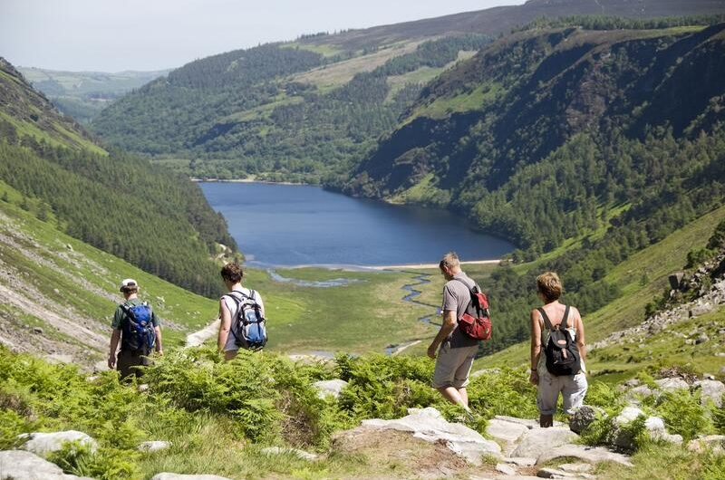 A group of walkers Descending into the Glenealo Valley at Glendalough Co Wicklow