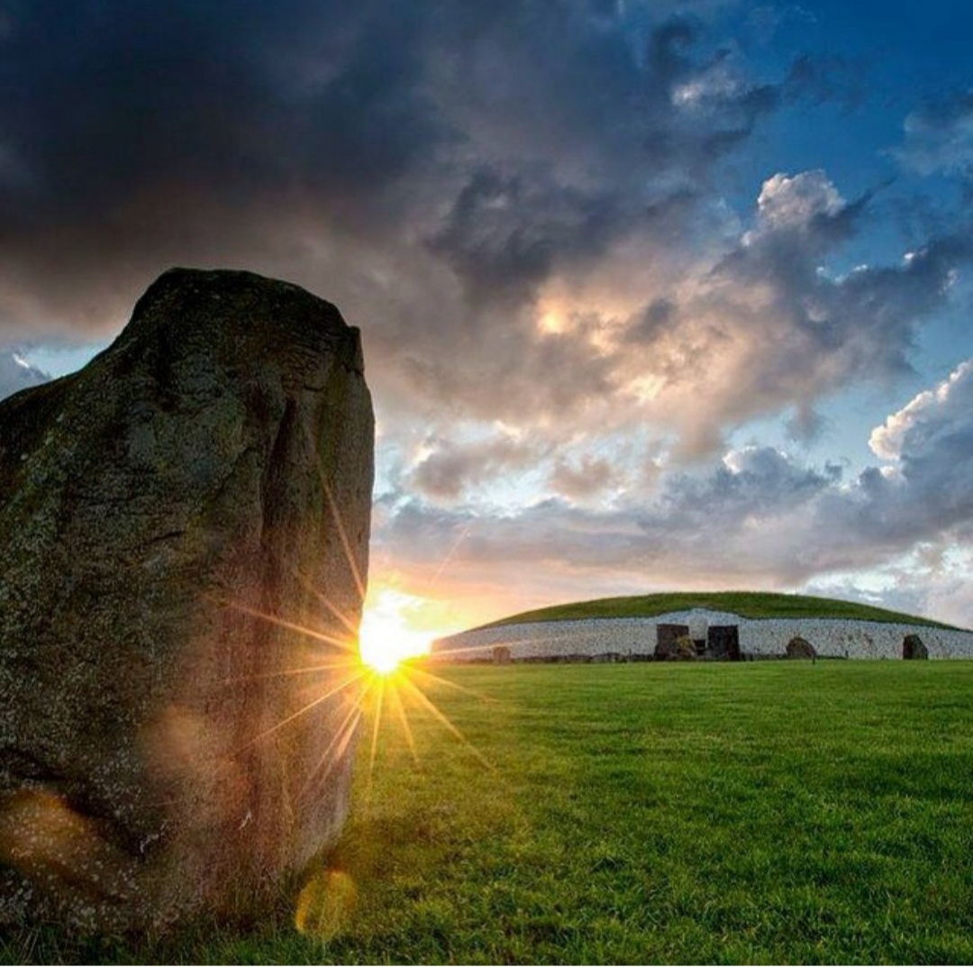 rays of sunshine reflecting on Newgrange Passage Tomb, Boyne Valley